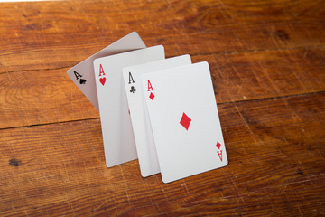 Aces on a wood background