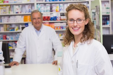 Smiling pharmacists looking at camera