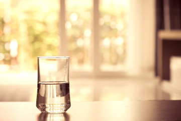 closeup Glass of water on table in the living room