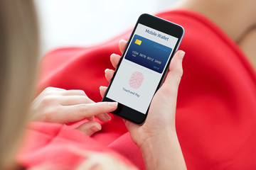 woman holding phone with fingerprint for online shopping