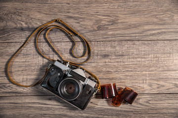 Old retro camera on vintage wooden background