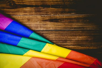 Gay pride flag on wooden table