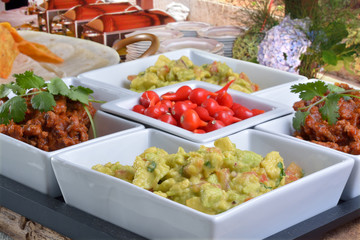 Mexican food - chilli, guacamole, tortillas and nachos