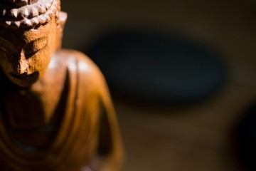 Wooden buddha statue on table