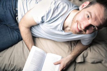 Reading a good book in bed