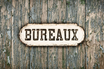 Retro styled image of an old French office sign