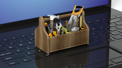 Toolkit with various tools on laptops keyboard