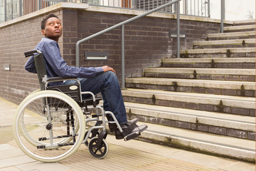 young man in a wheelchair waiting for help