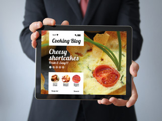 businessman with cooking blog on a tablet