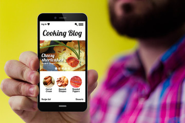 Hipster smartphone with cooking blog on the screen