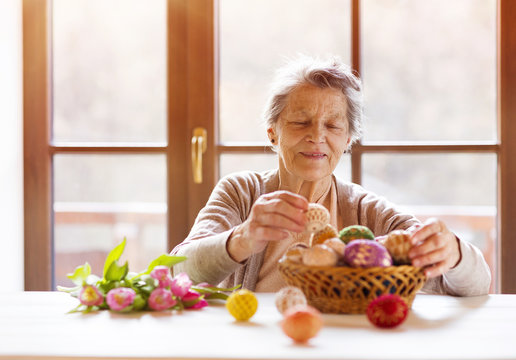 Senior woman with easter eggs