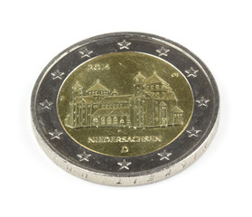 two euro coin closeup on white background..
