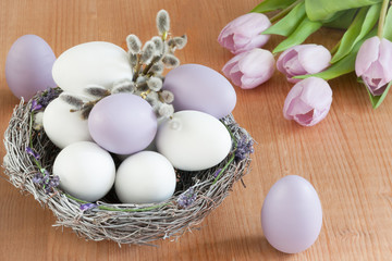 Lilac and white eggs in a nest. Easter decoration