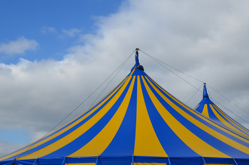 Blue and yellow circus big top tent