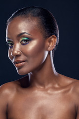 Beauty portrait of handsome smiling ethnic african girl, on dark