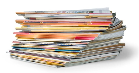 Article. Stack of magazines isolated on white background