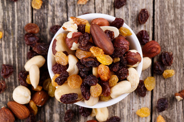 Mixed nuts on a white plate.