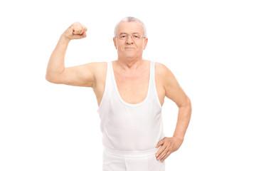 Senior smiling man in white underwear showing bicep