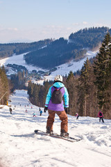 Skiers and snowboarder descends from the mountain