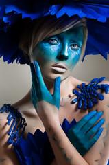 Creative beauty shot with cyan headdress