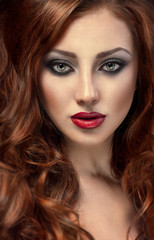 Beautiful woman with posh red hair