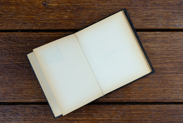open blank old notebook on wooden table