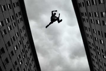 Man jumping from roof to roof Wall mural