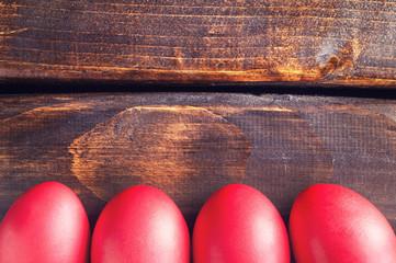 Easter eggs on old dark wood