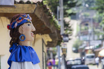 Side view of a giant doll in Ataco, El Salvador