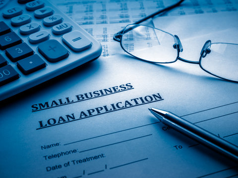 small business loan application on the desk.