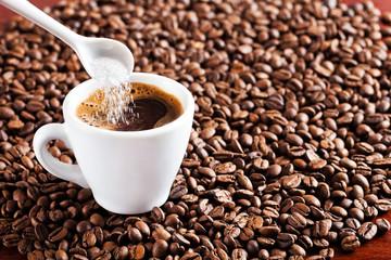 Fresh coffee drink, inserting sugar in coffee