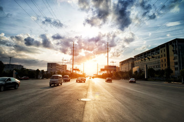 Fotomurales - skyline,road and building at sunset.