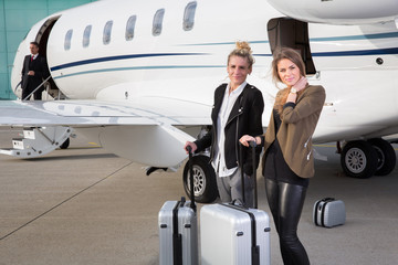 executive business team leaving corporate jet Wall mural