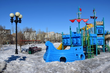 Playground for children in the park in winter