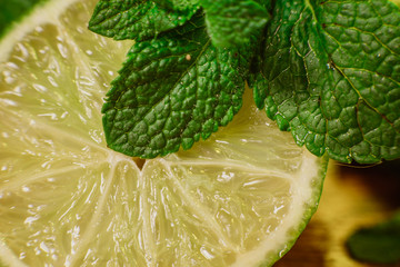 Lime and mint on wooden background