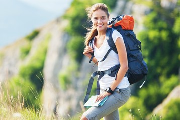 Hiking. Healthy lifestyle woman smiling outside Wall mural