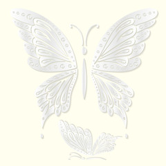 Set of decorative white butterflies cut from paper