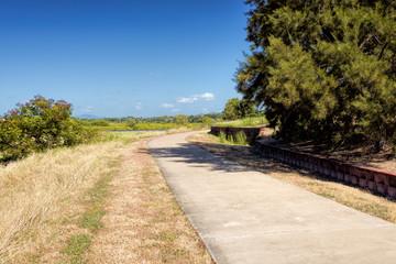 Narrow footpath goes along fields