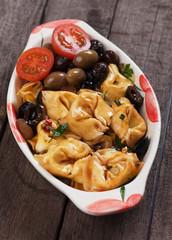 Tortellini pasta in olive and tomato sauce