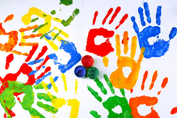 Hand prints of paint with paint on white background