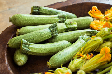 Fresh courgettes or zucchini with flowers