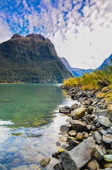 mountain reflection on the water at Milford Sound New zealand