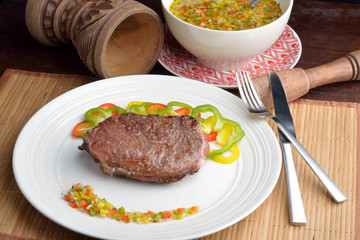 .steak with vinaigrette: sweet pepper, onion and tomato