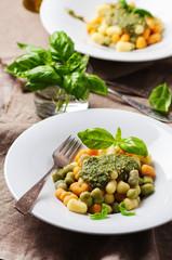 Colored gnocchi with pesto
