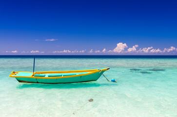 Colourful boat on a wonderful crystal clear ocean