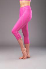 Beautiful legs of sporty woman in leggings