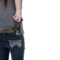 Woman Pulling her Hand Gun from Hip Holster
