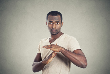 confident casual man showing time out gesture with hands