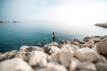 Woman on the rocky beach