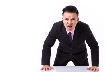 angry businessman shouting, screaming, looking at you